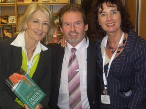 October 2007.  Geoffrey + Suzie receive a signed copy of Sandra Howard's latest book