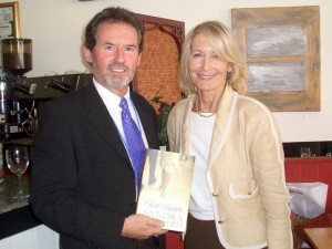 Sandra Howard presenting Geoffrey with a copy of her book