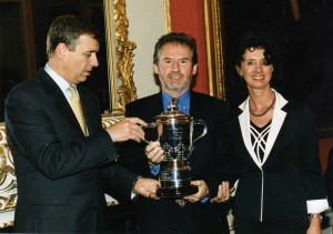 Geoffrey and Suzie being presented with the Kings Cup by Prince Andrew.
